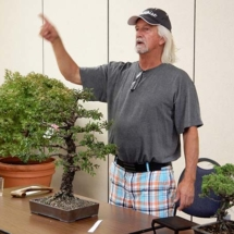 Jay McDonald, as auctioneer, about to auction off a wonderful cork elm bonsai.